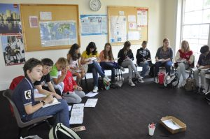 Students learn English in a conversation lesson at English for you in England