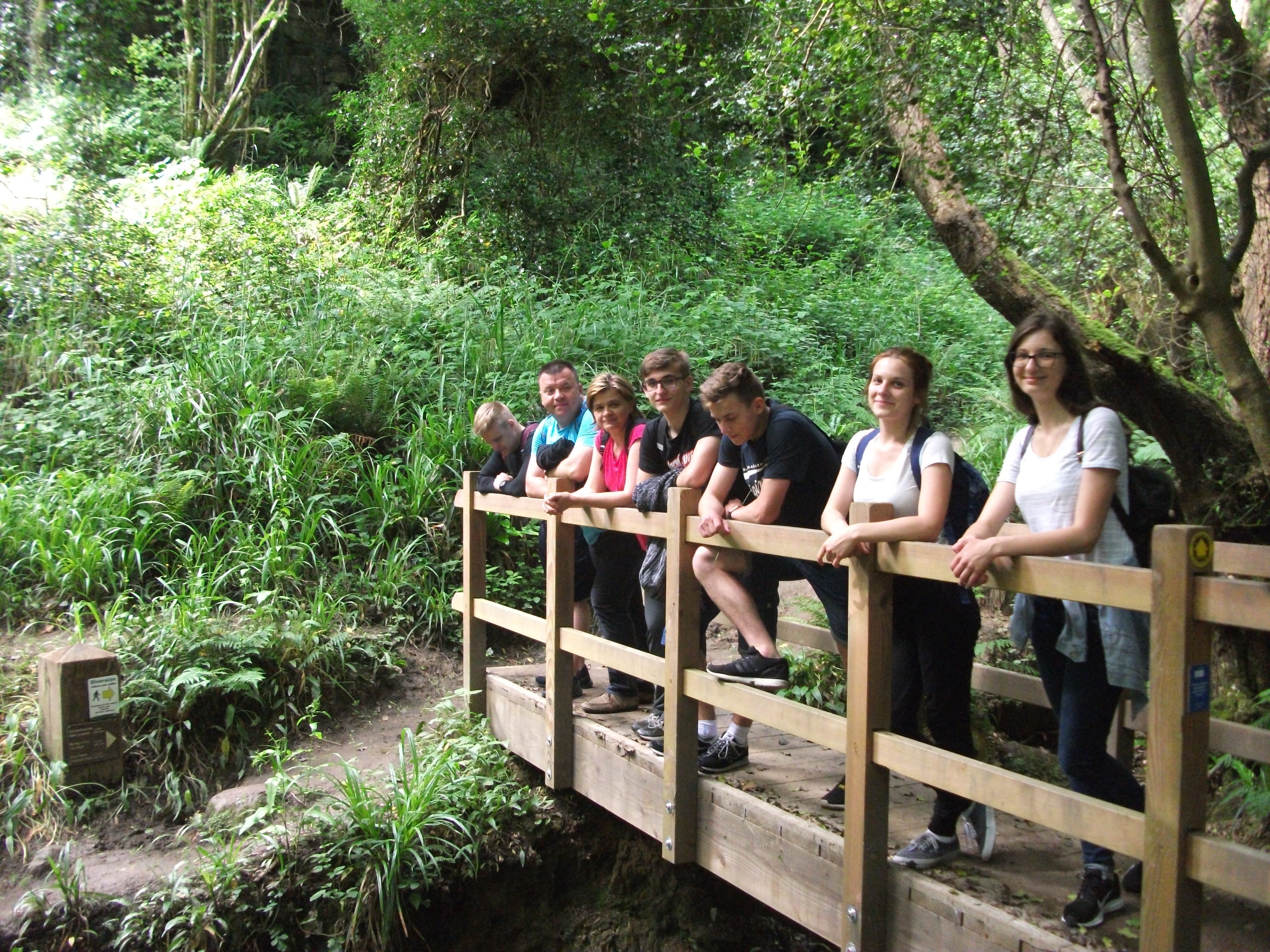 English language students study English in England relax during a countryside walk